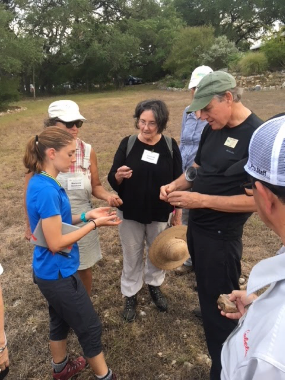 Tom Jones works with members of the 2018 Master Naturalist class in identifying and talking about different pieces of flint and Karst Limestone encountered on the ranch walk