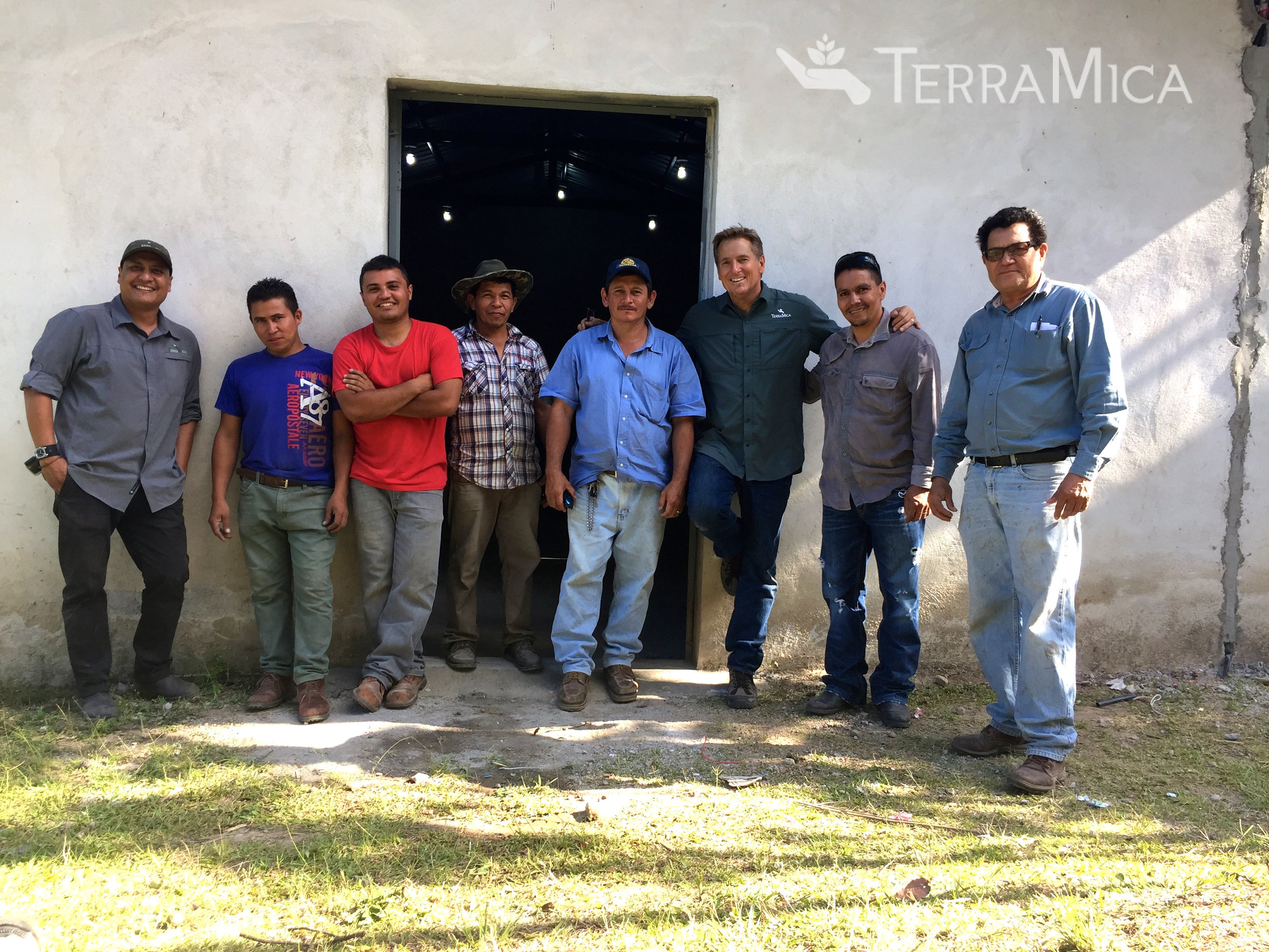 TerraMica  and the La Cayetana church electricity project - two of our staffers with some of the local men who participated in the project.