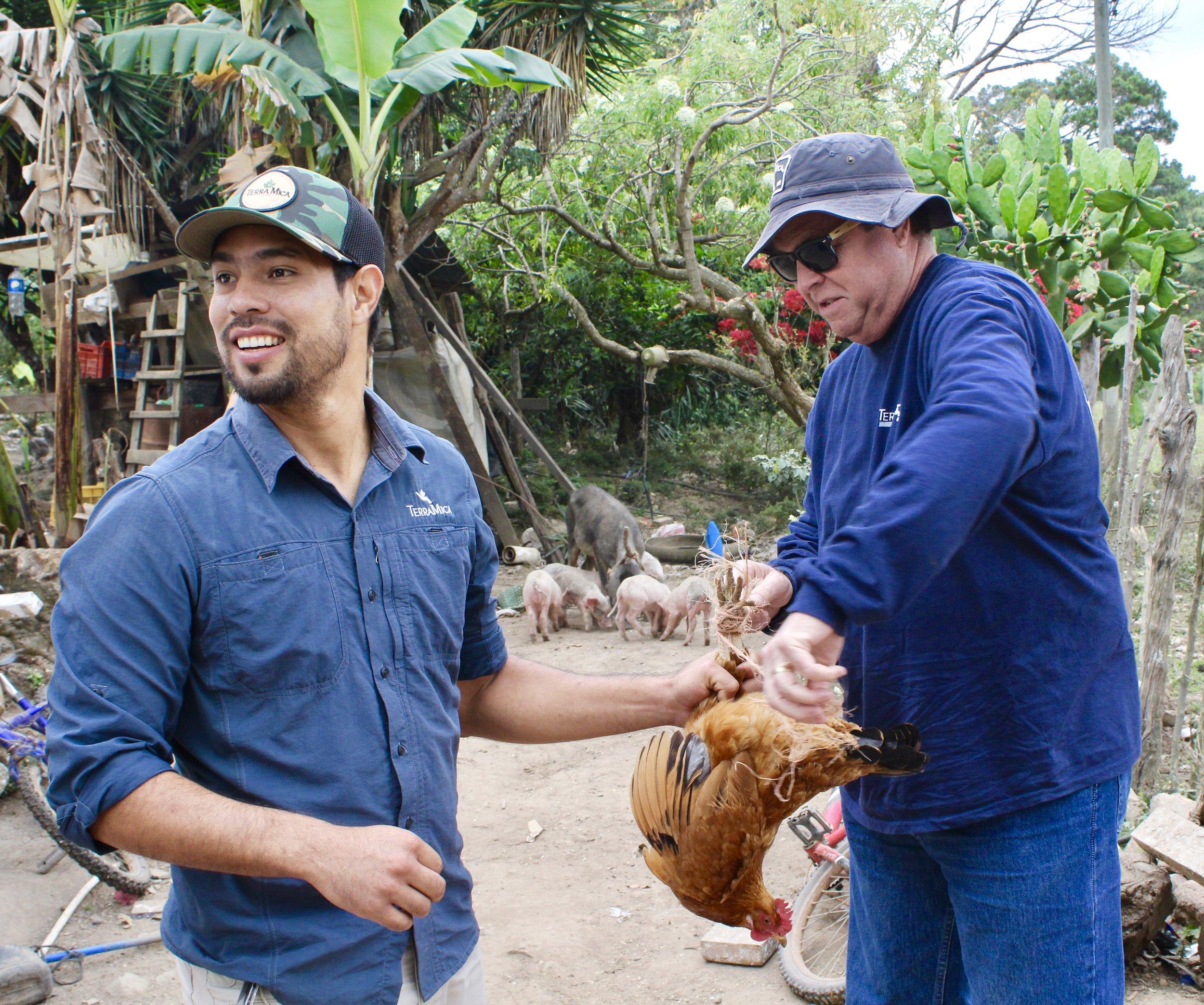 Men on Farm with Chicken