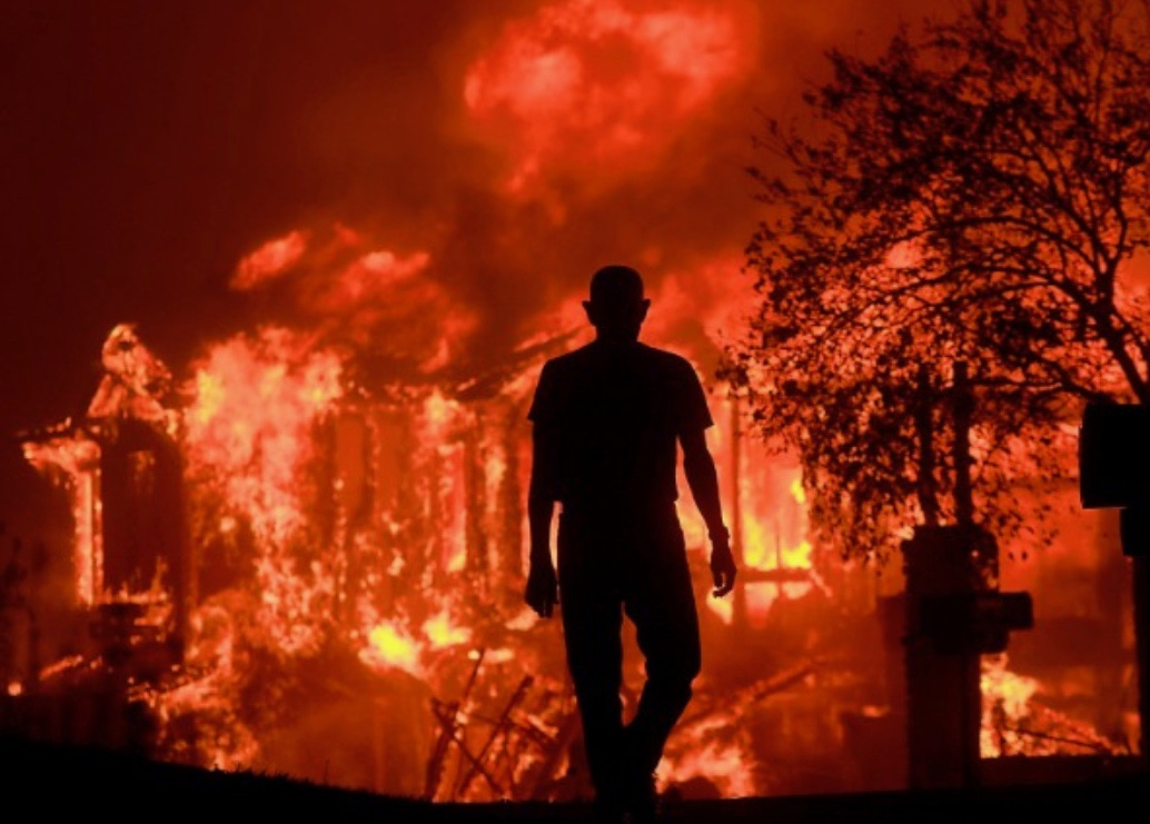 man in front of wildfire.jpg