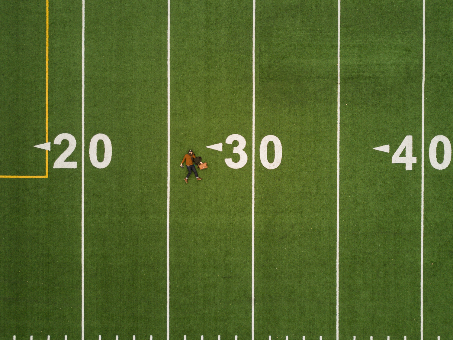 aerial-football-field-self-portrait-drone-martin-reisch-unsplash.png