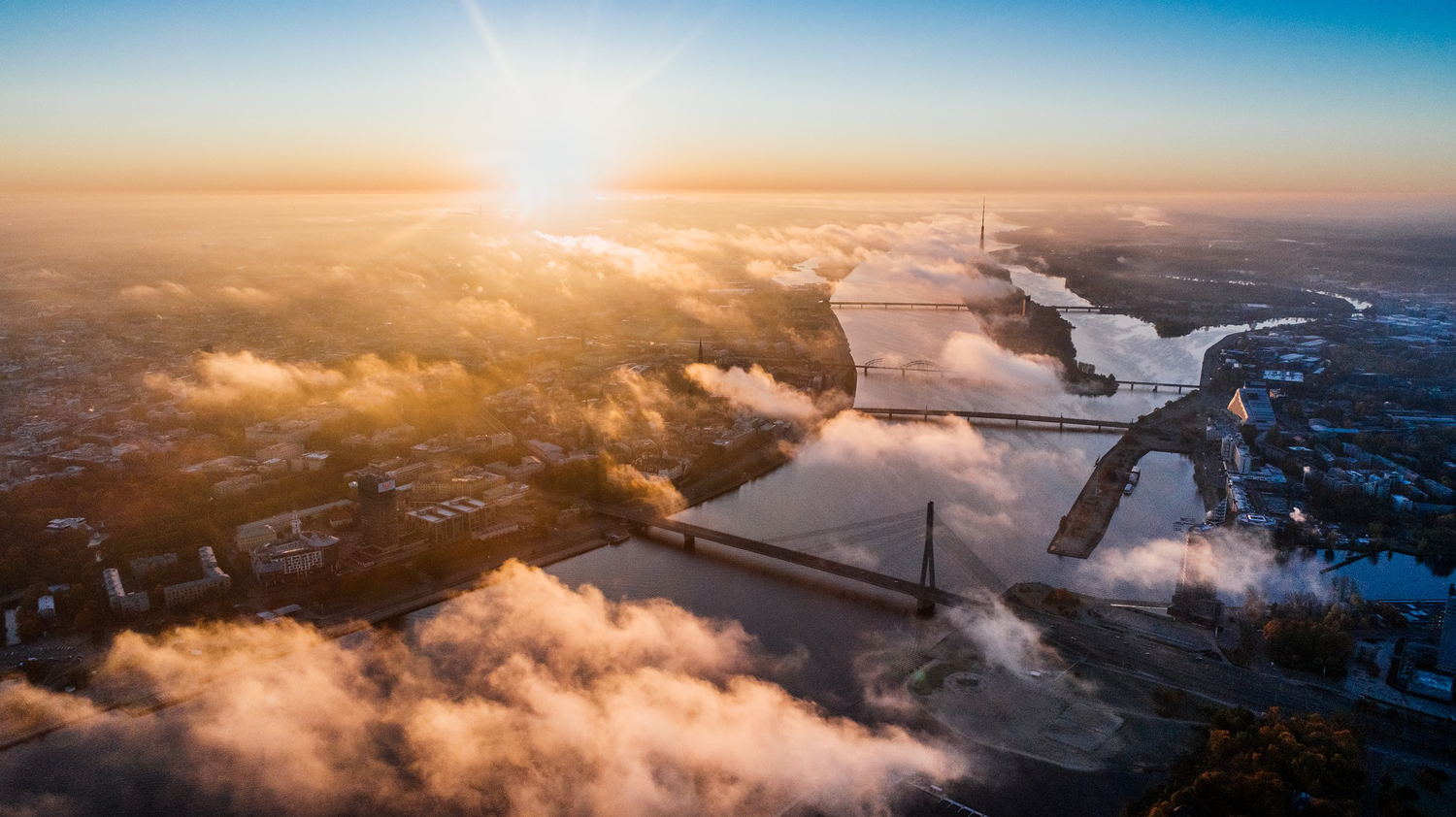 aerial-view-city-bridge-sunset-drone-alex-unsplash.png