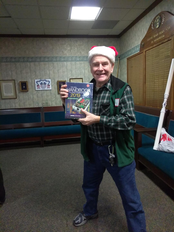 Bob Sumption W9RAS - Bob takes the ARRL 2019 Boxed Handbook Set.