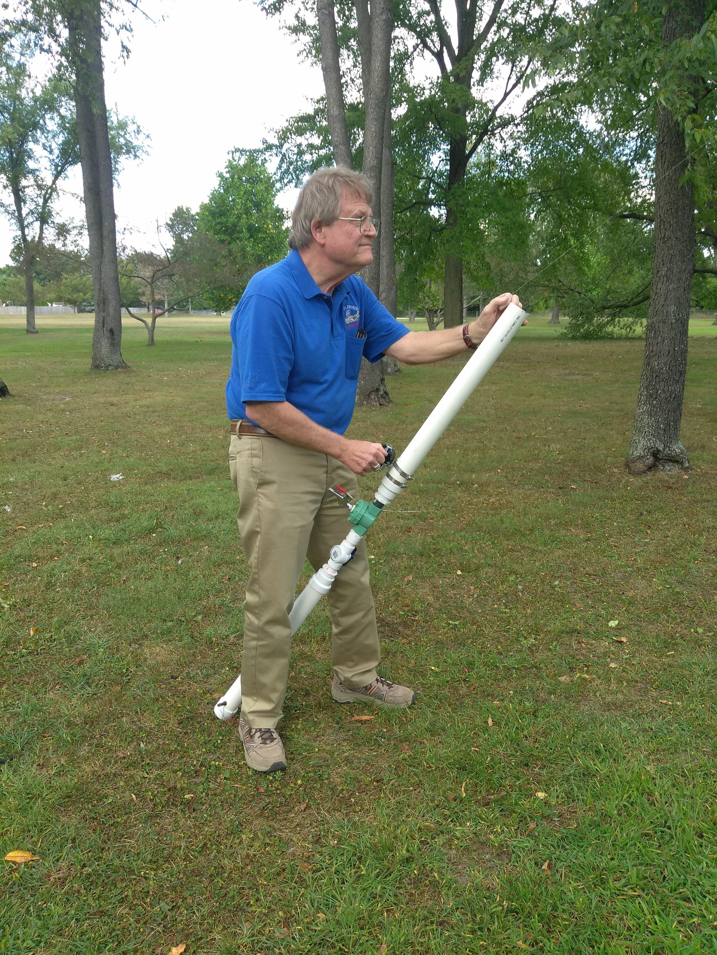 - Keith Wishmeier WA9S launching an antenna line into the trees.
