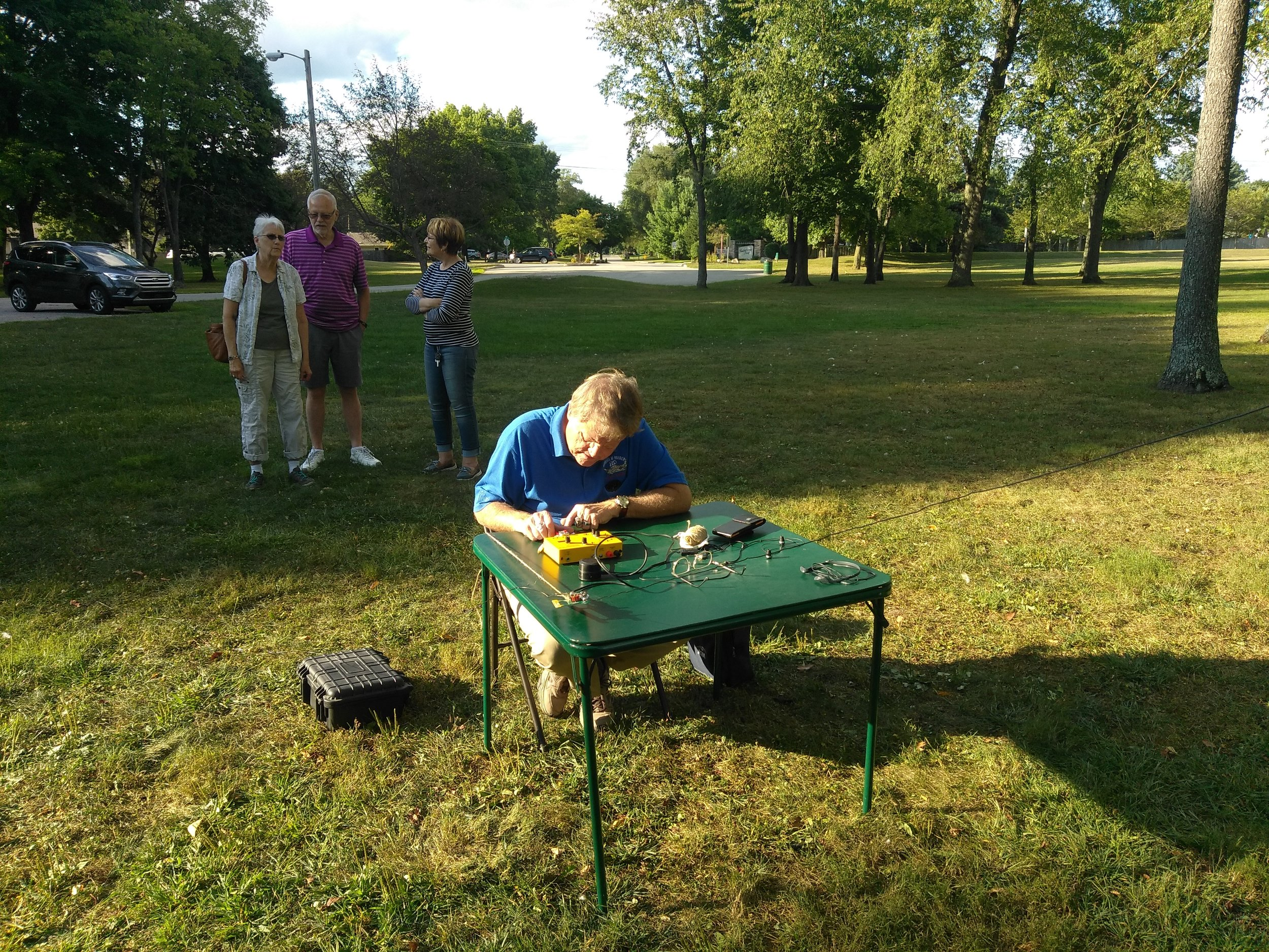 Keith Wishmeier WA9S operating 40 meter QRP, wife Mary in background with Hal Brucseke KA9LAW and wife Bonnie.