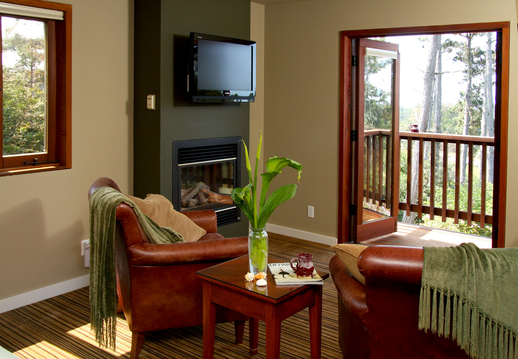 French doors open to the balcony with second floor view in the Osprey room