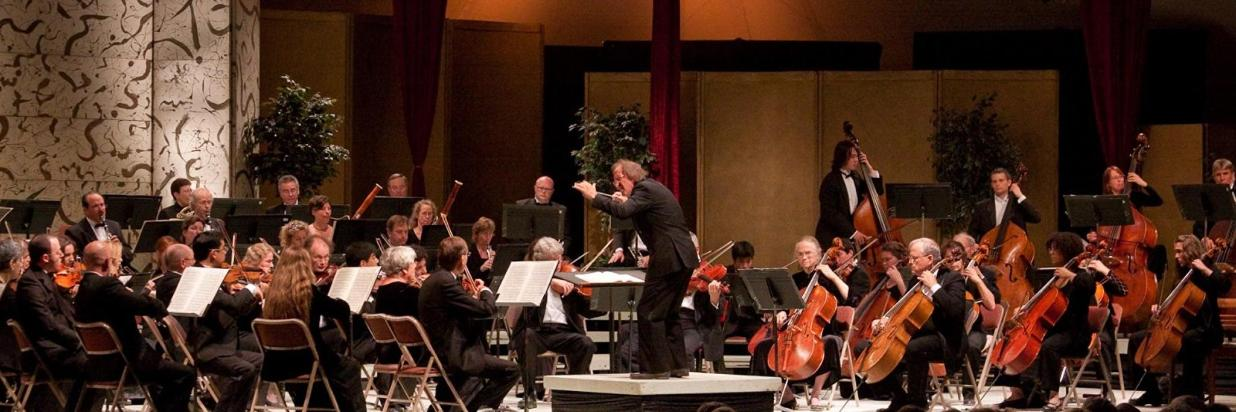 The conductor guides the orchestra through the music at the Mendocino Music Festival