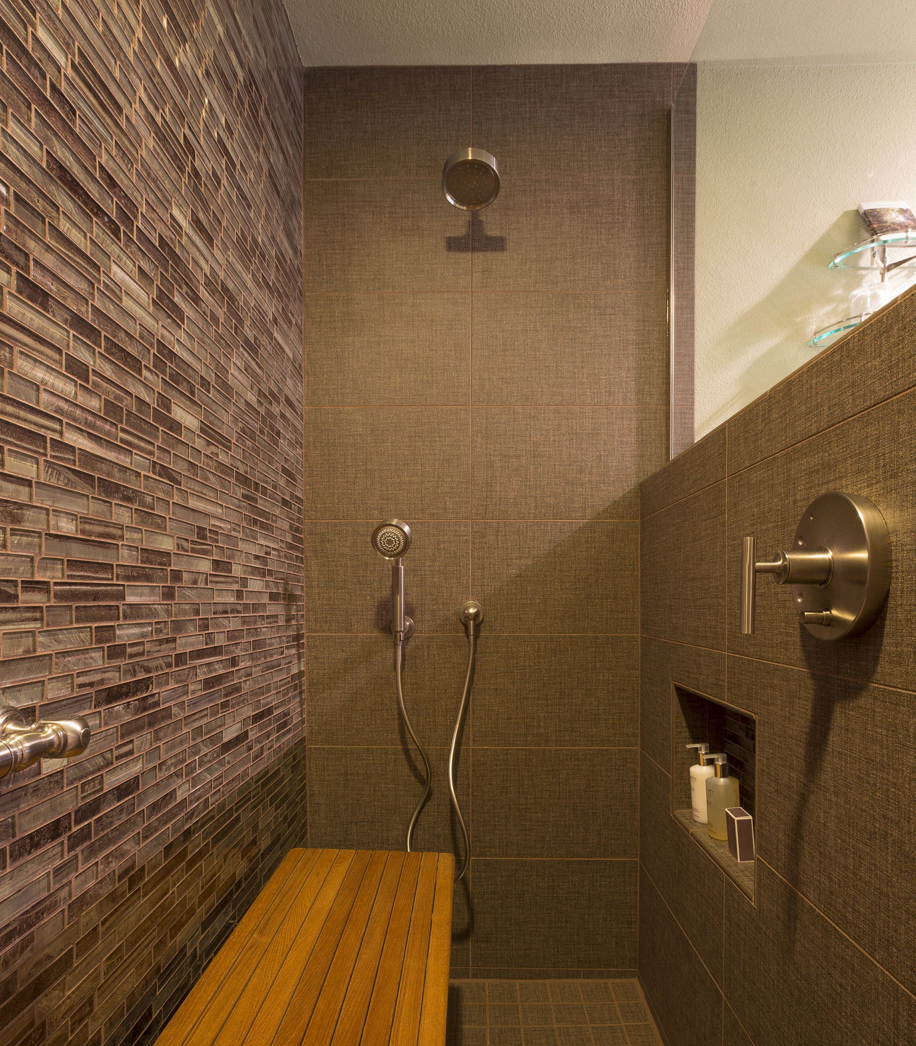 our ADA compliant shower with two heights of shower heads, bench, and grab bar
