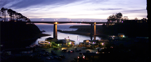An evening twilight view of the bridge above Noyo Harbor.