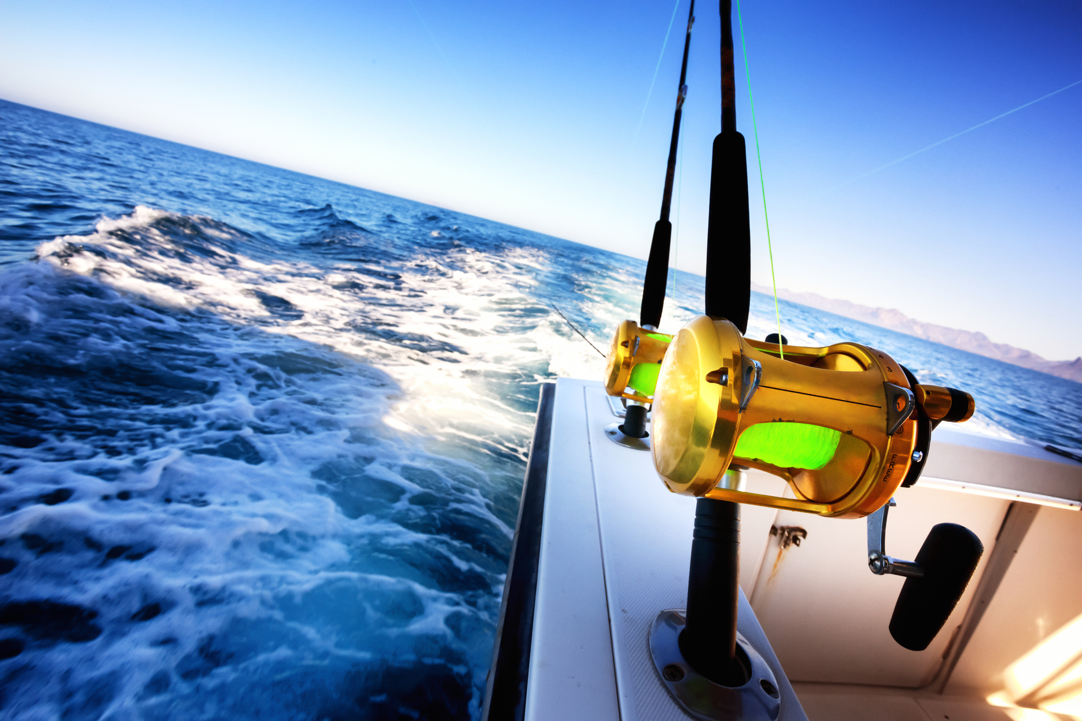 A sunny day on the ocean fishing from a boat.