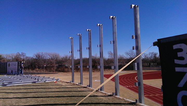 athletic field chain link fence being built