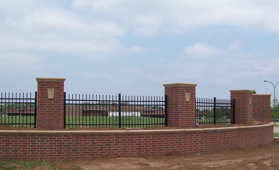 ornamental steel fencing around a school