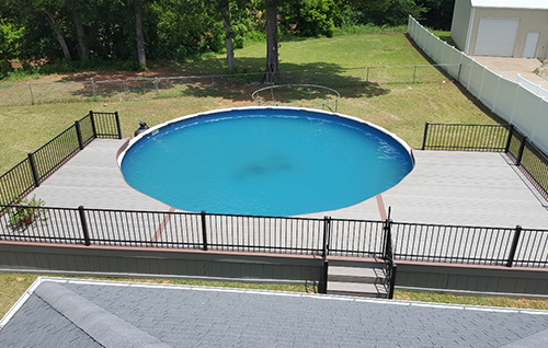 deck built around pool in backyard