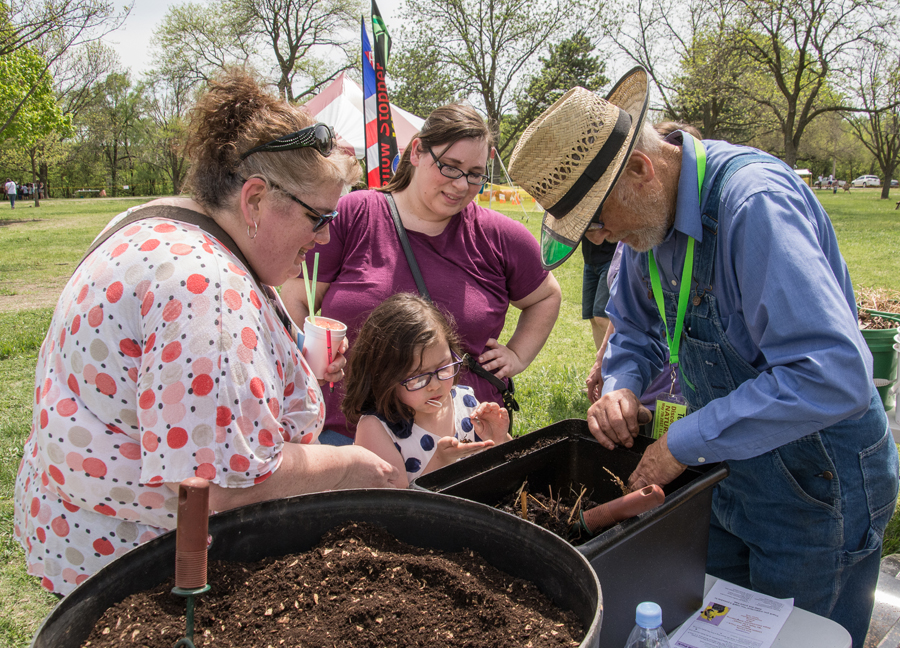 """Smoky Hills Audubon Society reaches out to area communities every year with a """"Discover Salina Naturally"""" festival. Attracting several thousand visitors each year, the festival educates and entertains young and old alike. Here Ted Zerger explains how composting turns household scraps into thick black soil for gardens. Healthy soil is a foundation for wildlife and recycling creates a sustainable future for the state. The yearly festival held on the first Sunday in May features, 70+ exhibitors from live animals to fossils complimented with great food and entertainment."""
