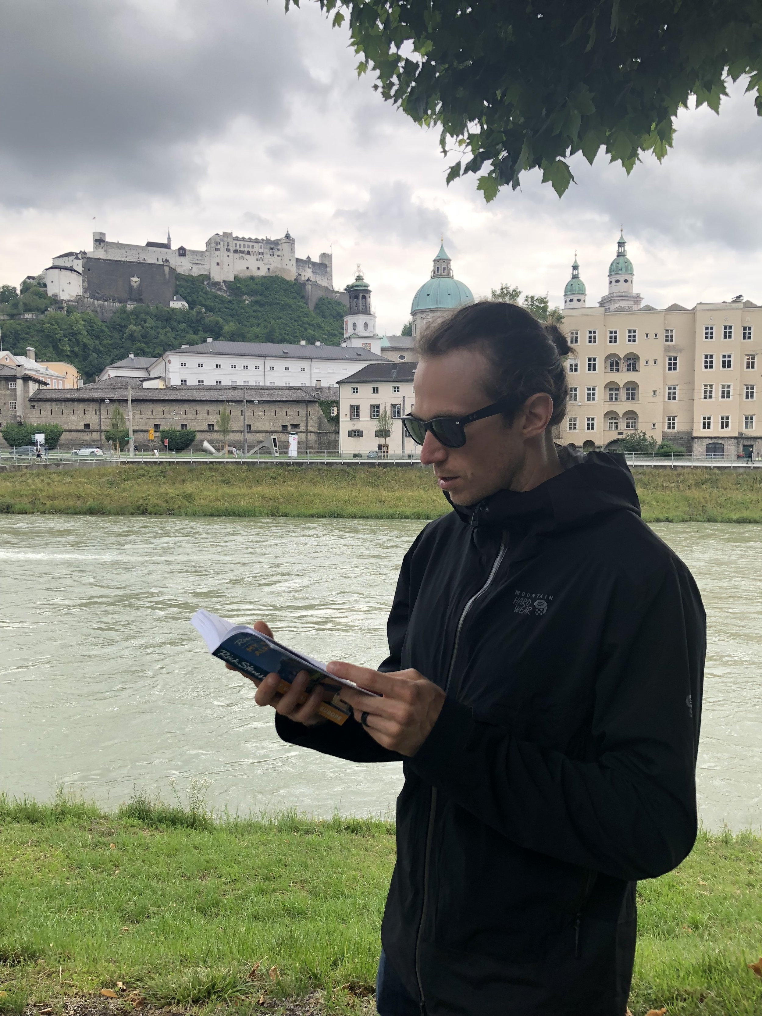 Spencer reading from the guidebook as we followed Rick's city walk through Salzburg