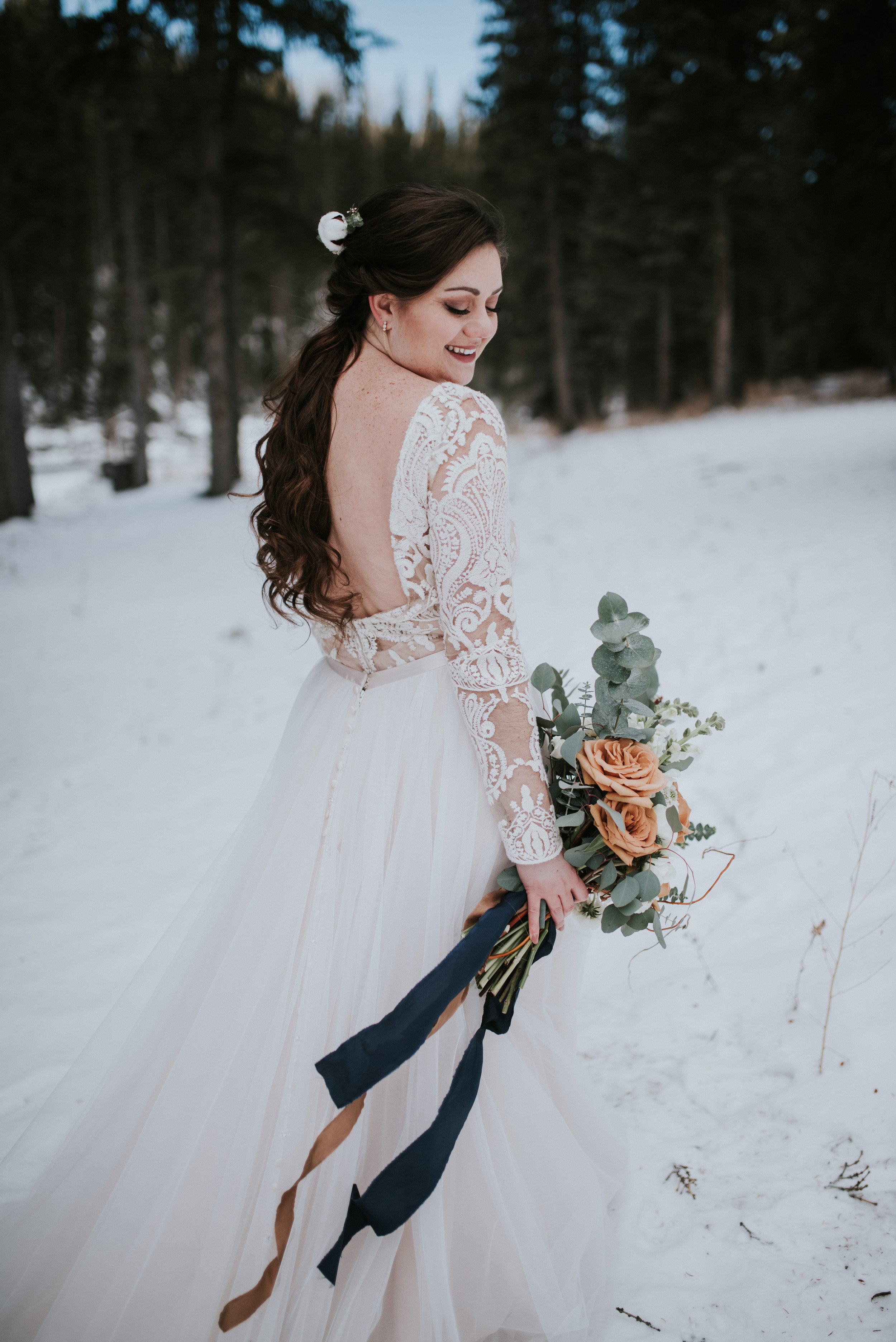 calgary winter wedding bride gown floral arrangement