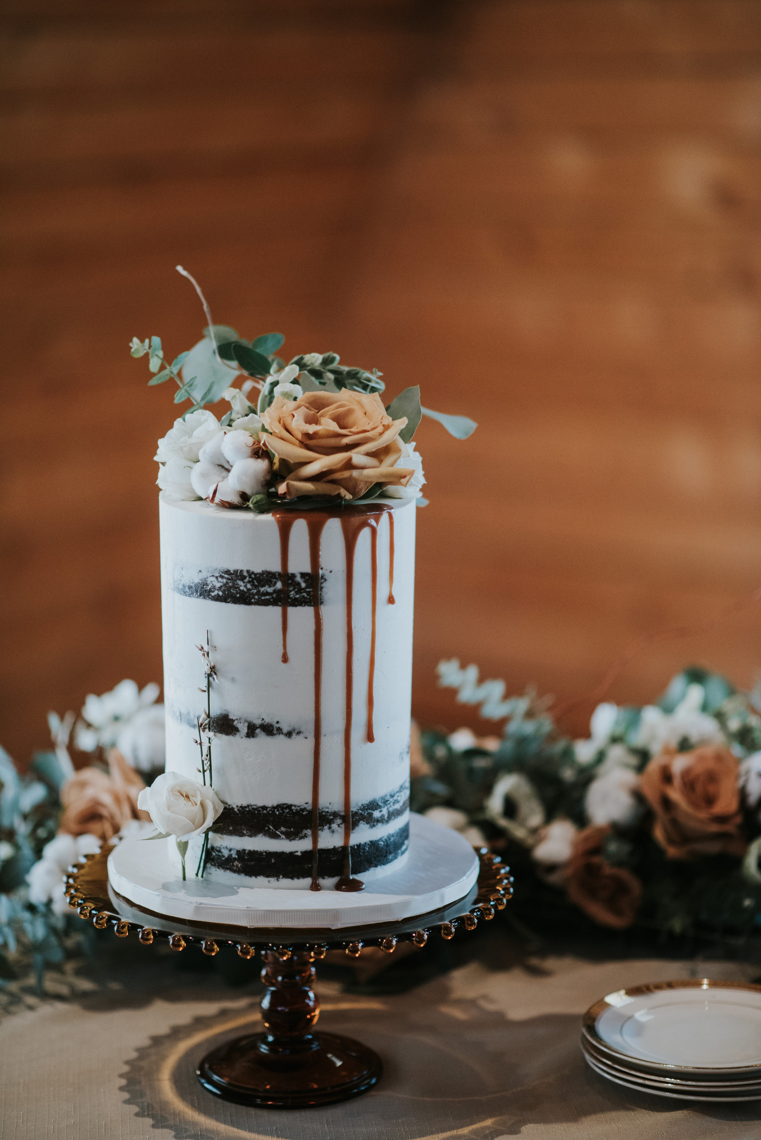 calgary wedding cake caramel drip naked cake design