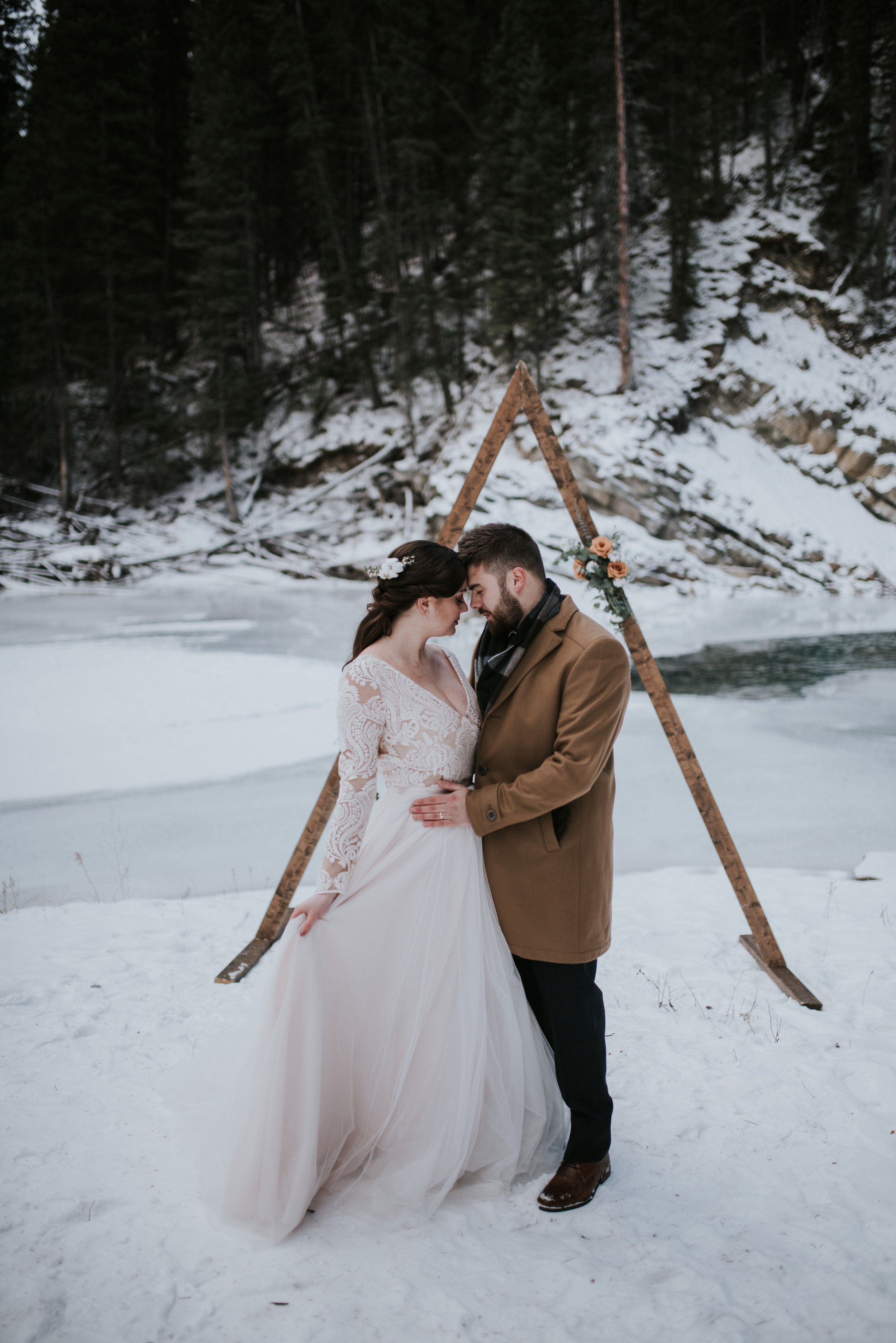 calgary winter wedding bride and groom outdoor ceremony archway