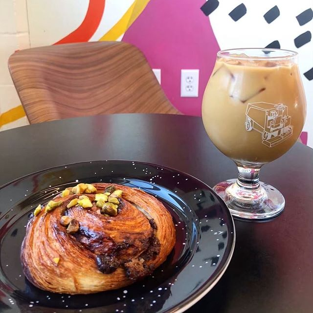 Love this shot by @minneats and this dynamic duo; a @dogwoodcoffee cold brew and our chocolate pistachio danish!