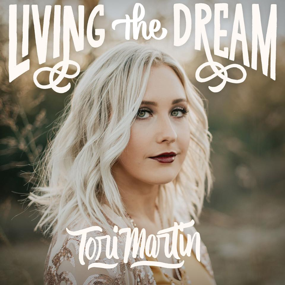 "Living the Dream - This song is an anthem for dreamers. We may face many ""no's"" and shut doors, but we never give up. We chase after what we love with everything we've got. I've pursued music for almost 10 years and wrote this song when I first moved to Nashville. It will always be special to me and I hope it inspires others to fight for their dreams!"