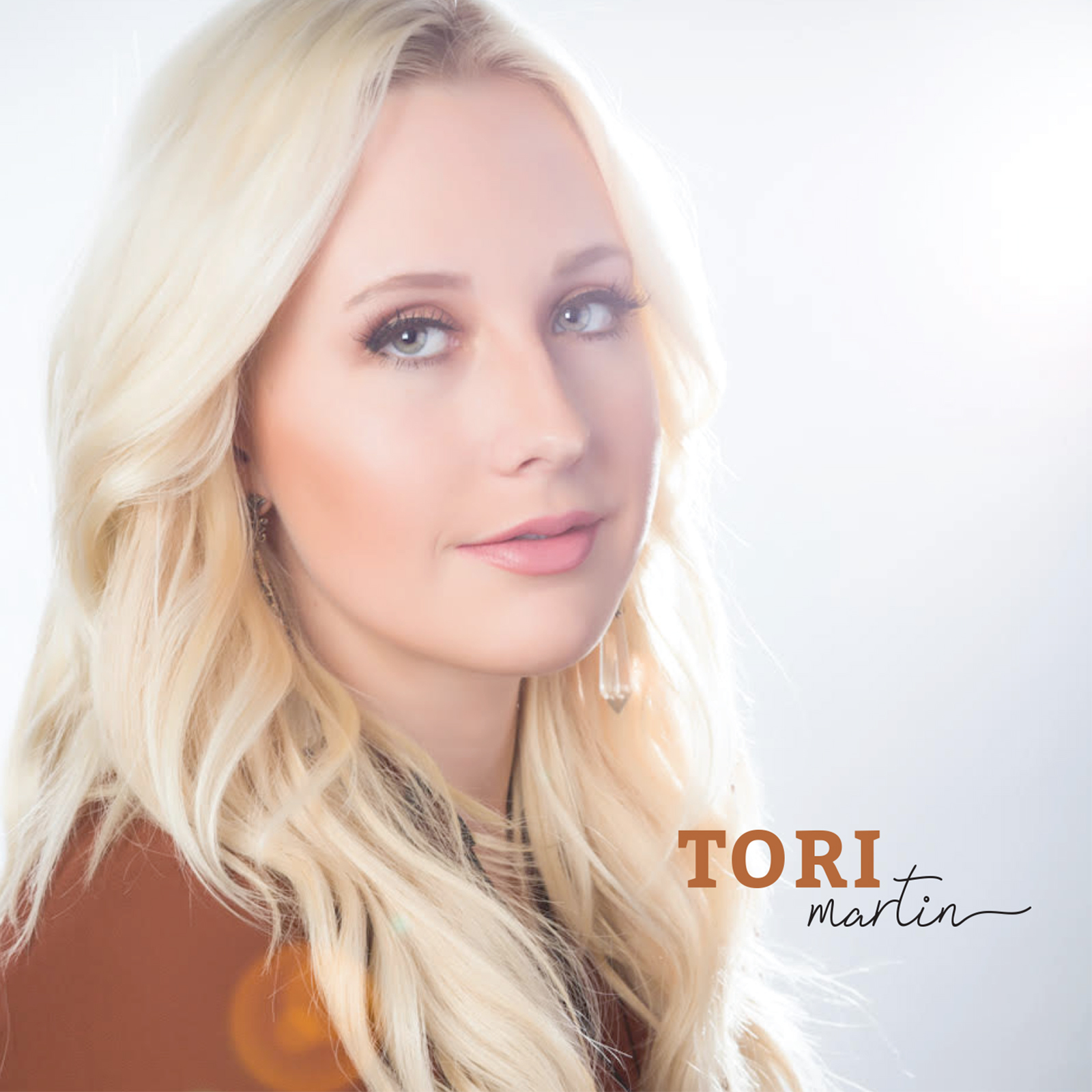 EP:Tori Martin - 2017The warm light of sun breaks through the clouds with these country-pop songs. A 'Caged Bird' who has had 'Enough' is finally free to soar. And as she learns 'Day By Day' not to get bogged down in the 'Quicksand' she goes 'Coastin' through life, falling in love, and she has 'Never Looked Back'.The songs on this project are about finding love, and finding yourself - coming of age - opening your eyes and seeing what is around you. Musically it is an EP with lots of good melodies that are fun to sing. It's a good example of an artist finding their voice and wrapping it around songs that fit.