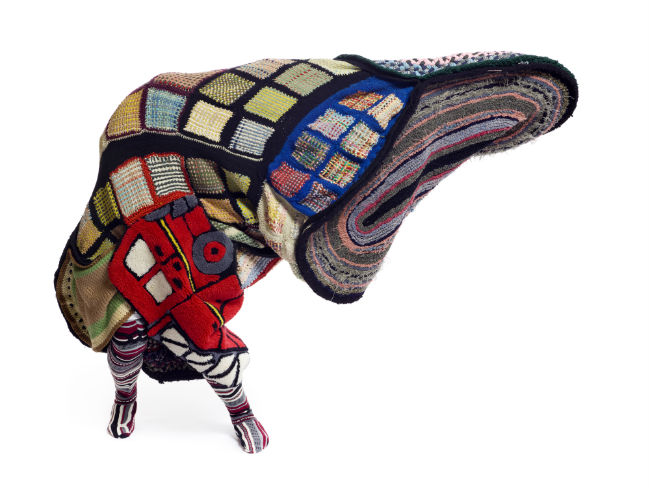 Nick Cave (b. 1959, Missouri), Soundsuit, 2011, Mixed media including rugs, afghans, metal, fabric, and mannequin, 98 1/2 x 21 1/2 x 20 inches, ©Nick Cave. Photo by James Prinz Photography. (Courtesy of the artist and Jack Shainman Gallery, New York)