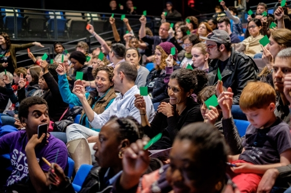 The audience votes on which policy proposal to follow through with, at the May 13, 2017 Legislative Theatre Festival at BRIC. Photo by Will O'Hare.