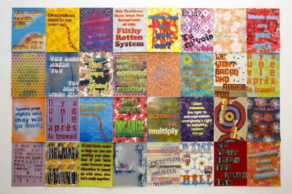 Andrea Bowers, Workers' Rights Posters, 2013. Spray-paint on gift wrapping paper. Image courtesy of the artist and Andrew Kreps Gallery.
