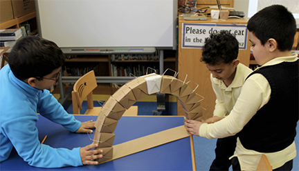 3rd graders at PS 133M construct bridges based on research of local structures and studied engineering strategies