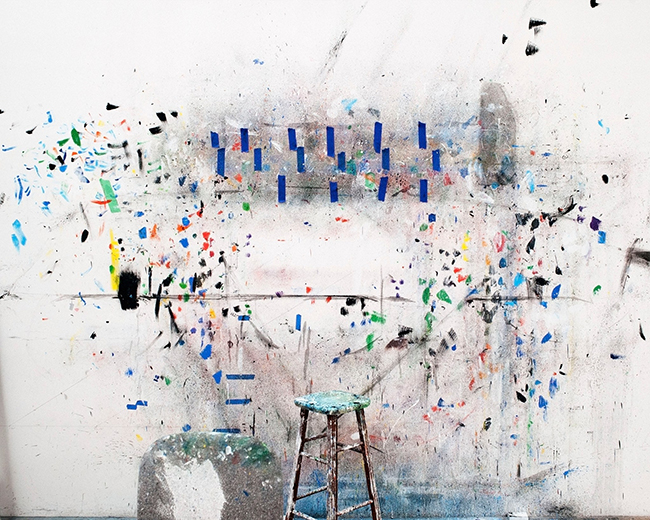 A nonprofit organization wants visual and performing artists to be fairly compensated for their work. [photograph of painting in studio, which has a white background with splatters of paint and geometric patterns, with a stool in the foreground]  Photograph by Alex Majoli / Magnum