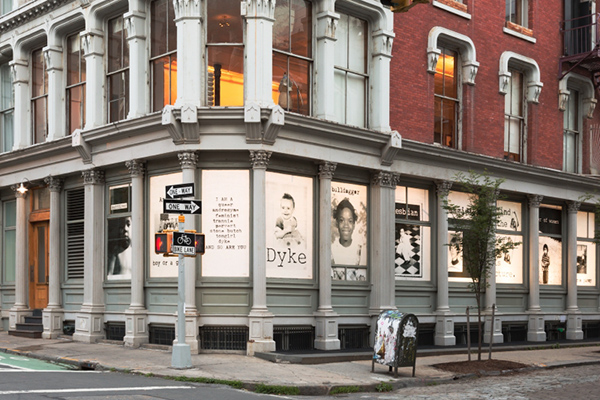 Photographs: Kristine Eudey, 2018, Fierce Pussy Facade installation, Leslie-Lohman Museum. [image description: exterior of the Leslie-Lohman Museum, all of the windows on the ground floor are covered in artwork. the art in the windows is of different portraits of the members of Fierce Pussy overlayed with different texts]