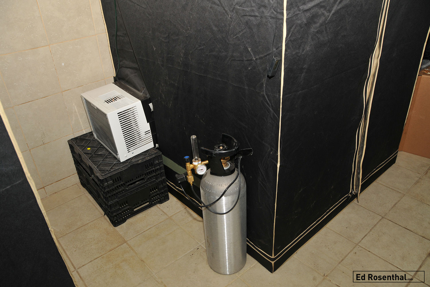 Outside of the grow tent, the air conditioner and CO2 tank are installed.