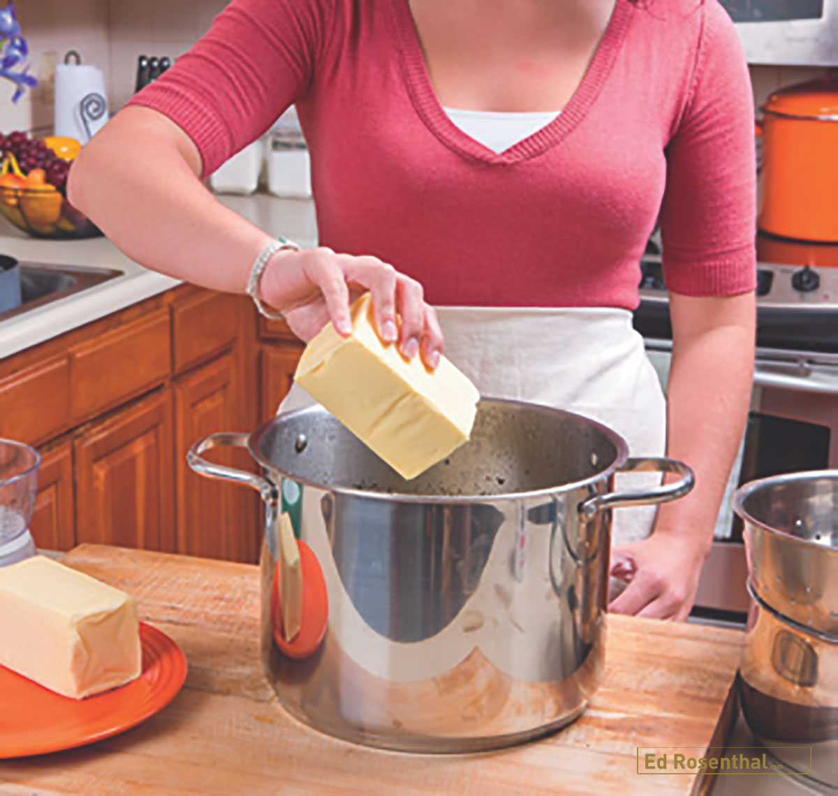 Putting butter into cooking pot