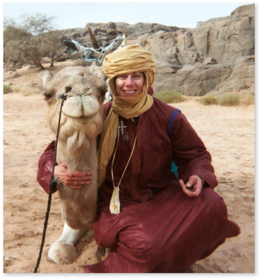 "With my riding camel, Anarani, in the Sahara Desert. He is also a character in my novel, ""The Rhythm of the Soul: A Journey of Loss and Discovery""."