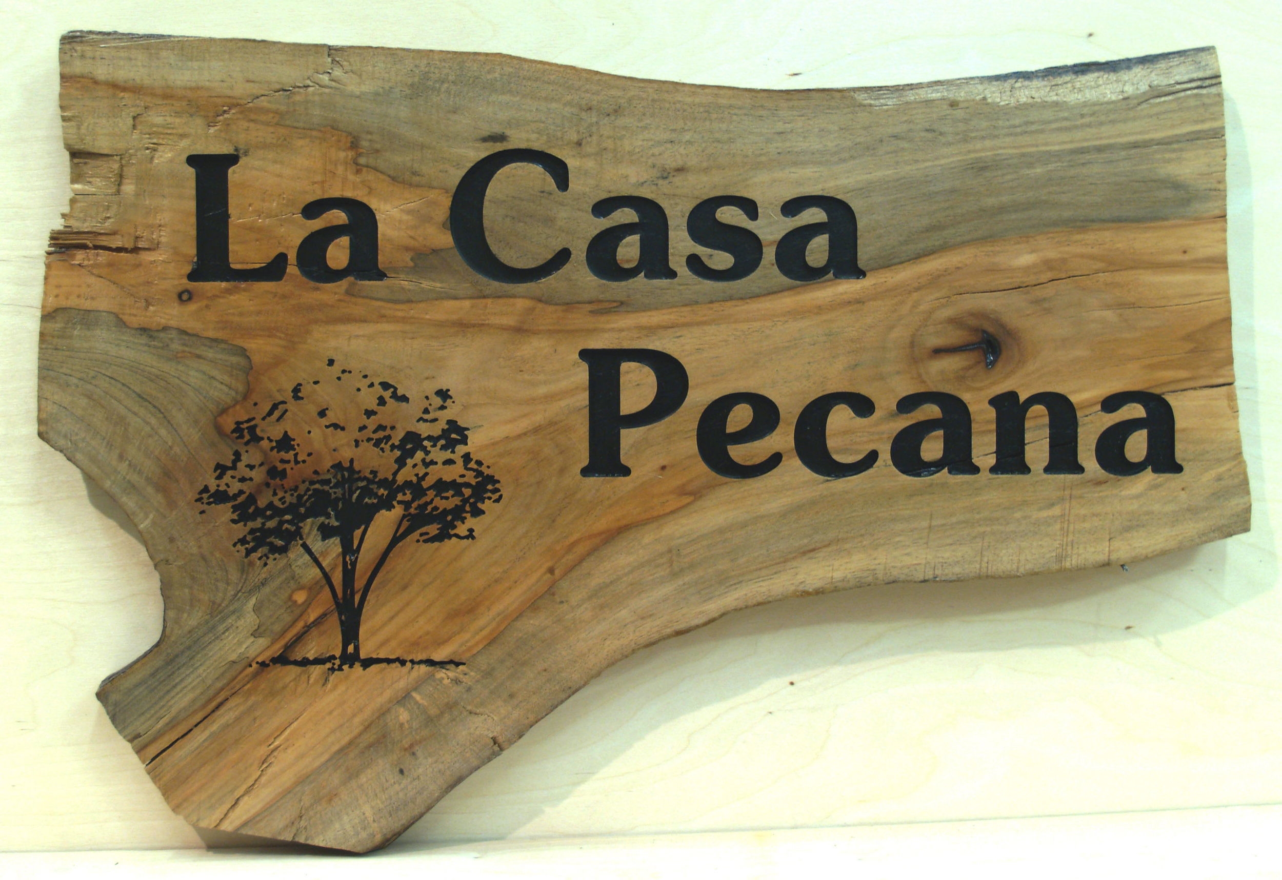 Routed sign from solid wood slab