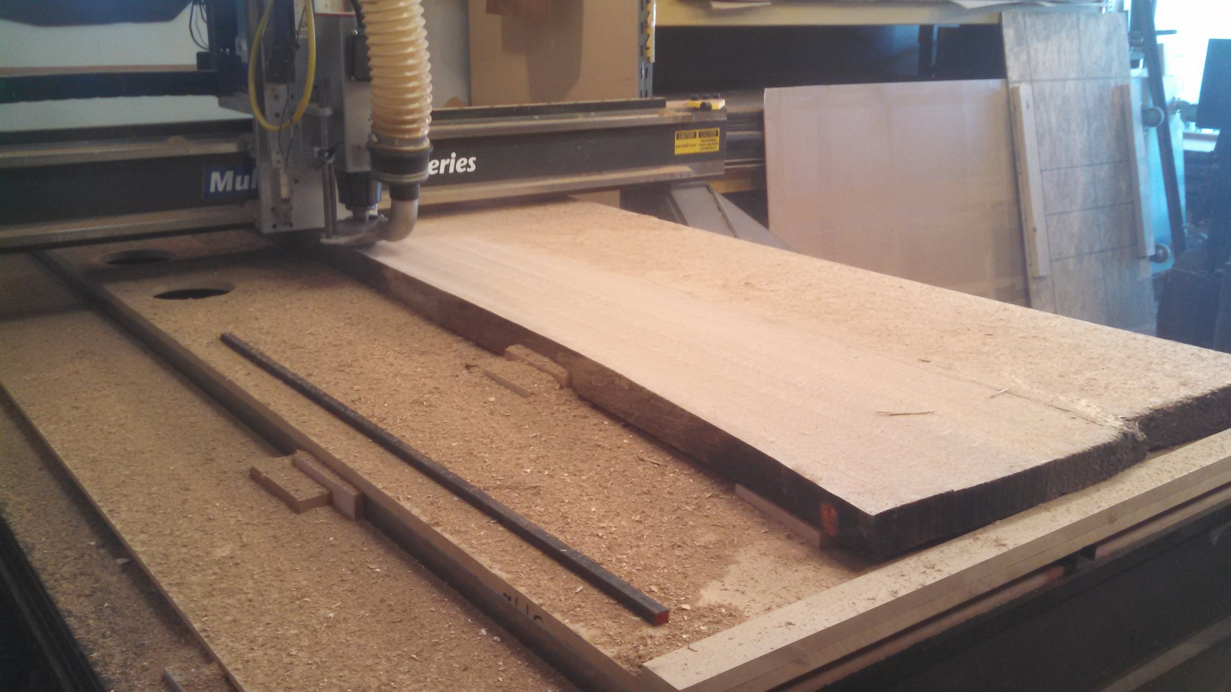 surfacing large live edge solid wood slab on our CNC router