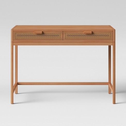 At $113.99 this Opalhouse Target  desk  is very budget friendly. However, I would  paint  it and change the pulls to gold.
