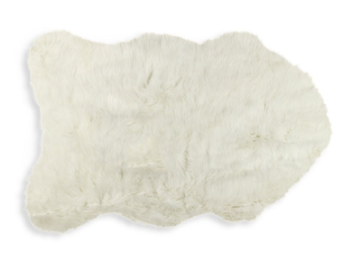 Drape this  2x3 faux pelt  from Saks Off5th for $24.99 over the rattan chair for a soft look