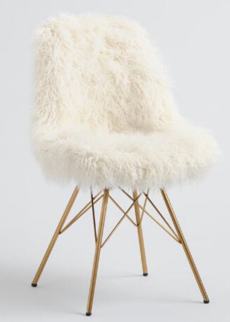 Love this fun I vory Faux Flokati Cypress Chair  from World Market