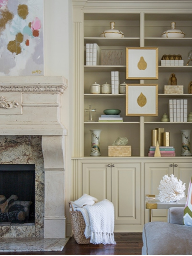 I love how Rachel Cannon of  Rachel Cannon Interiors  uses small works of art on the front of these builtins. Its so unexpected and supports and compliments all of the pieces in the room