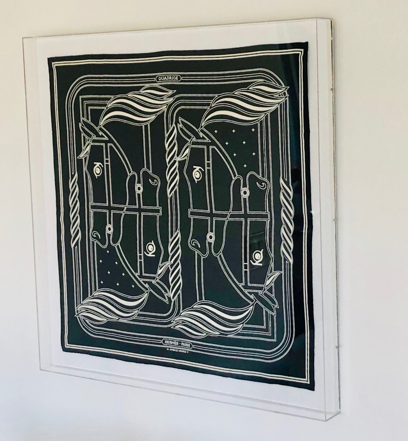 I framed this graphic black and white Hermes scarf in an acrylic floating frame. Framing a scarf is one of my tricks for creating instant large art. Check out my blog post about that  here .