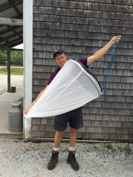 Tidepool Tim and his handmade marine plankton tow net.