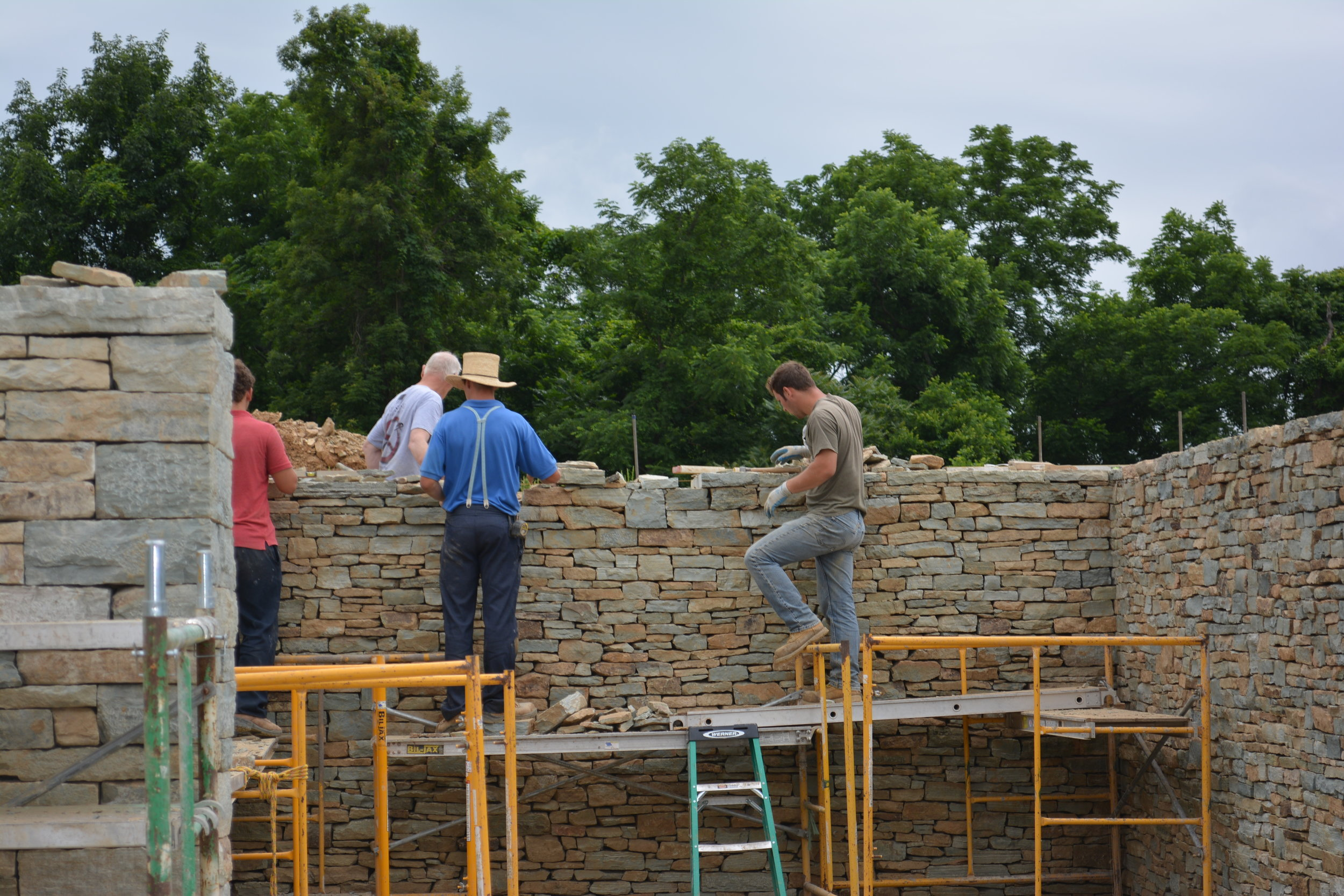 June, 2018 - the walls of the first auxiliary building are erected by hand by expert stonemasons.