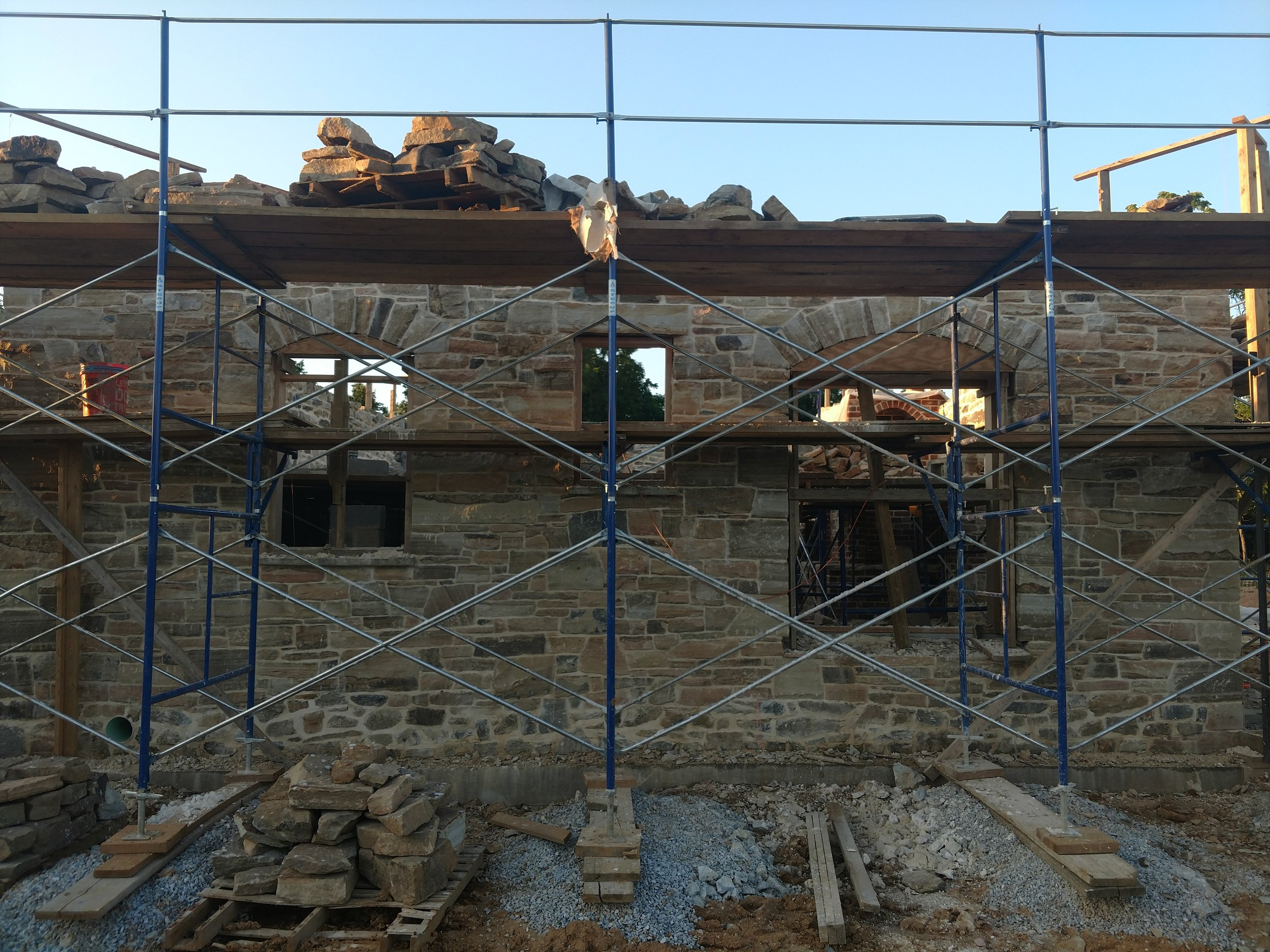 "The wooden forms or ""falsework"", seen in the windows, are arches which serve only to aid the construction and will be removed once the mortar has cured and the arches can support themselves."