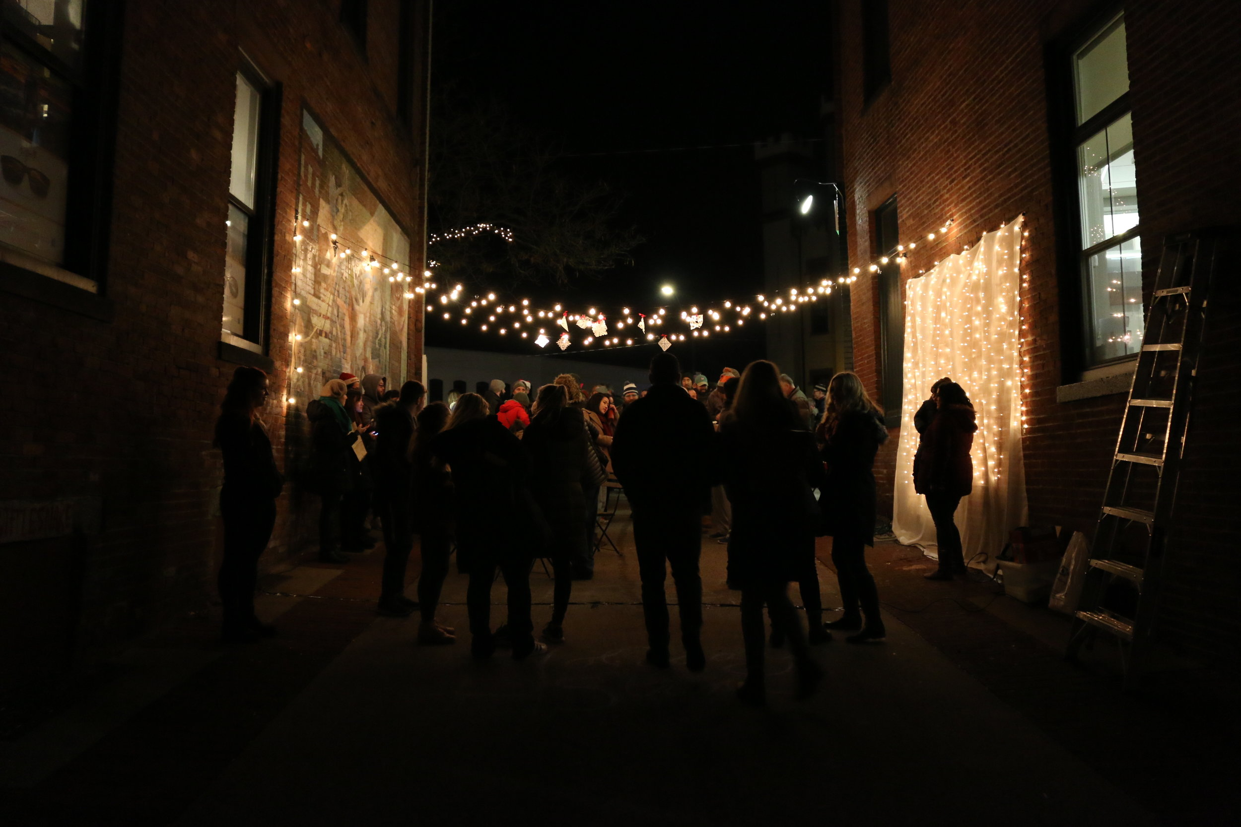Students Demonstrate Tactical Urbanism in Northampton, MA - On December 1, 2018, in Northampton, MA, UMass Students studying sustainable community development used tactical urbanism to transform a normally empty alleyway into a fun, festive, public gathering as part of the annually Holiday Stroll in center of town.A photo-story of the event was published by The Amherst Wire. click here to view