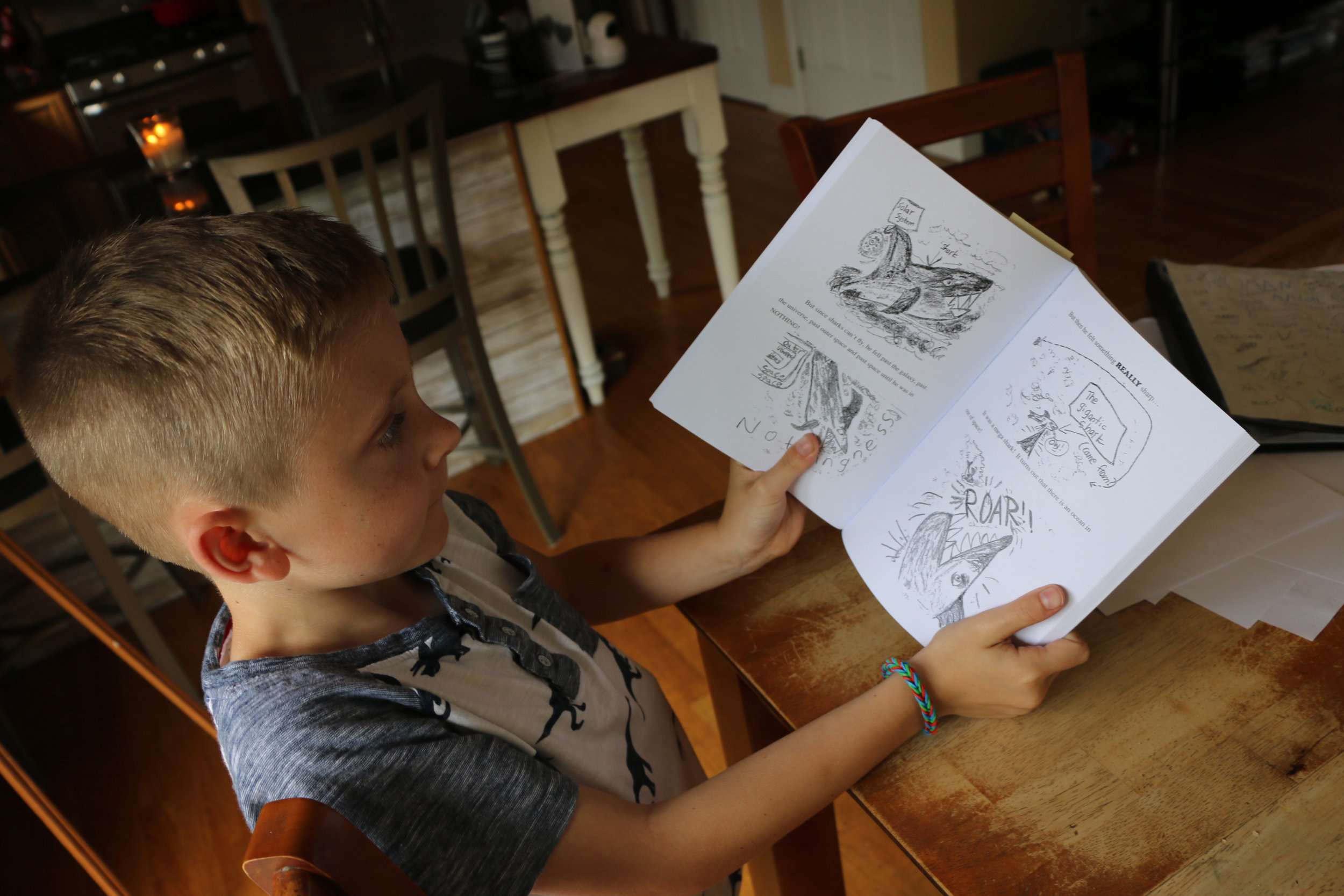 """Griswold 8-year-old writes and illustrates graphic novel - Eight-year-old Grady Haggan of Griswold has been writing and illustrating books since the age of 4. Earlier this month, he fulfilled a dream when he self-published his first """"epic novel.""""This story was published by the Norwich Bulletin. click here to view"""