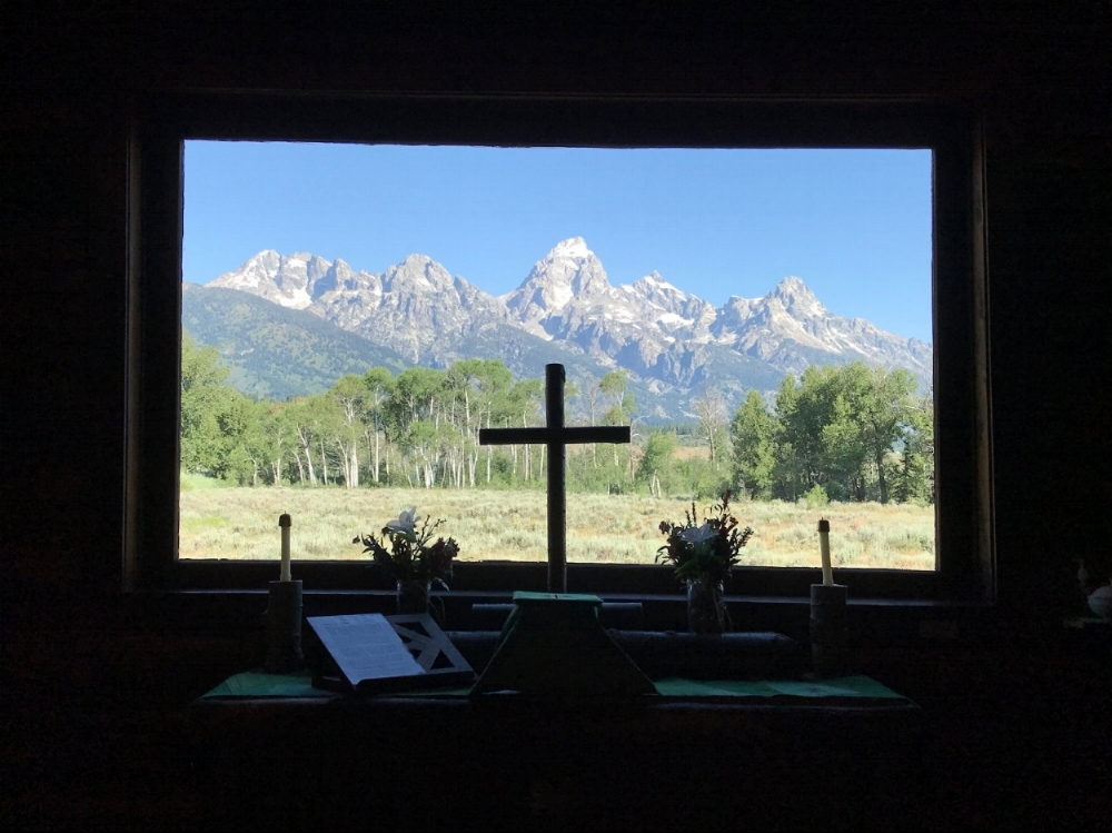 Inside the Chapel of the Transfiguration looking out at Grand Teton National Park