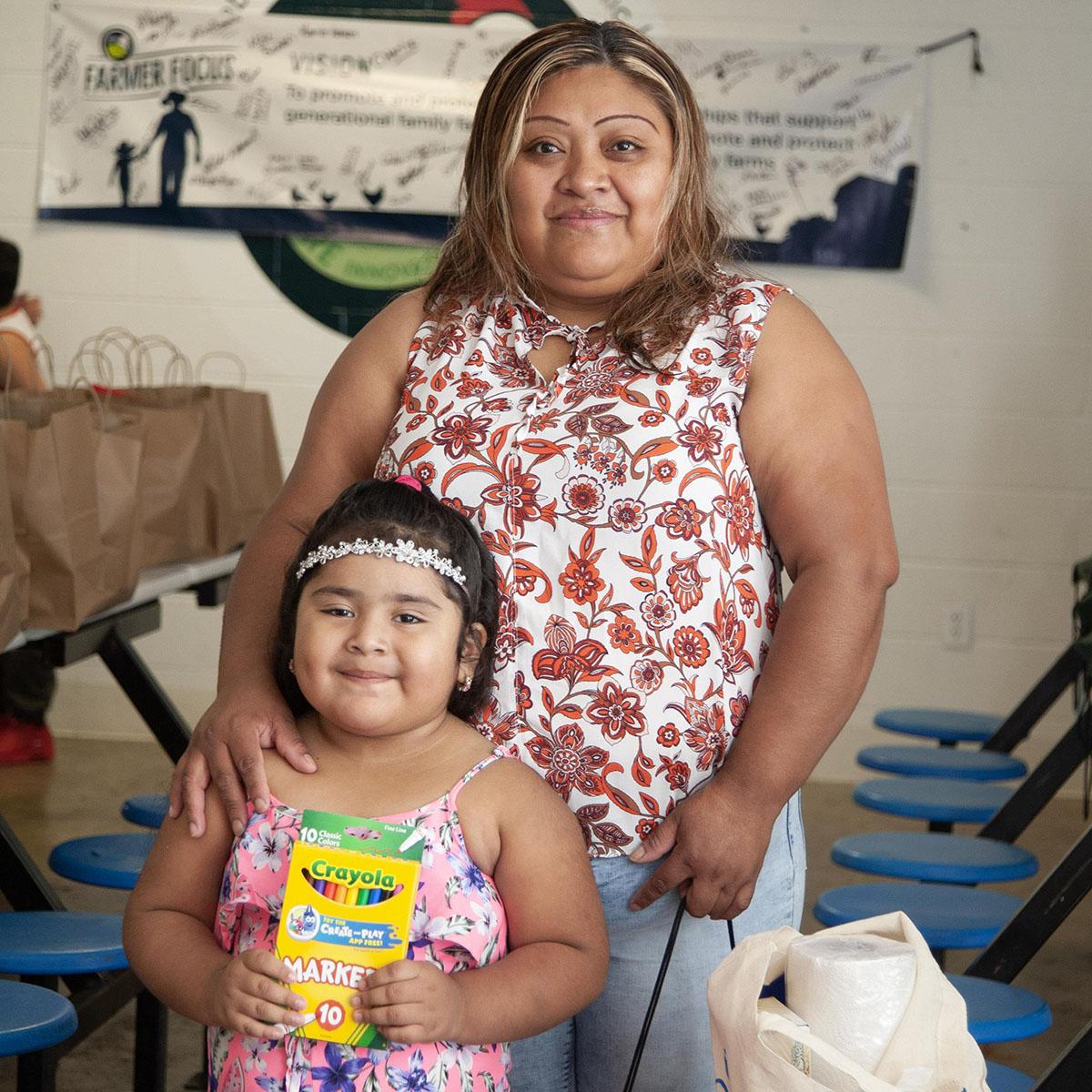 Milagros Reyes Cruz an her daughter