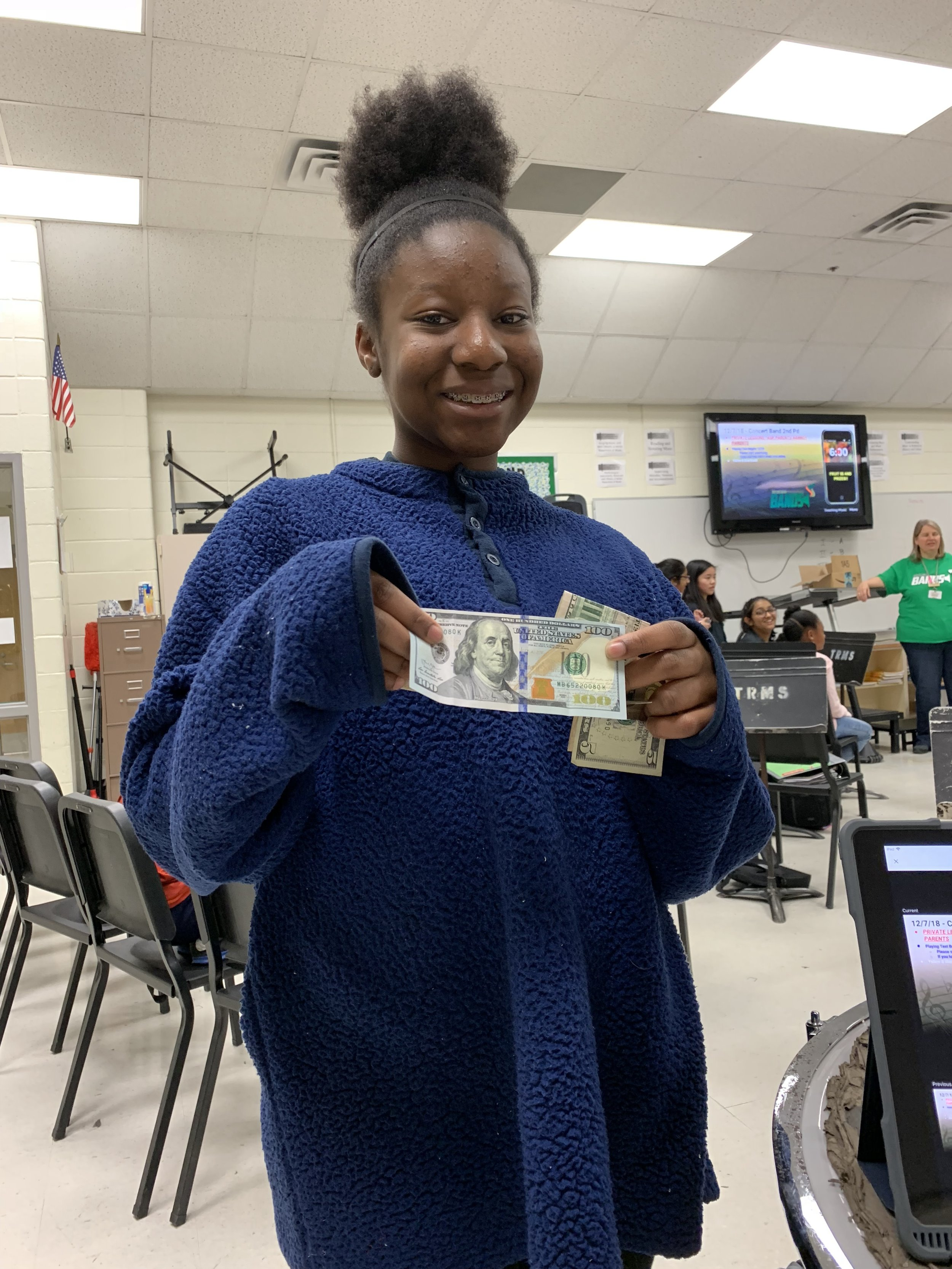 Dami was the lucky one to draw the $100 from the fruit sale!