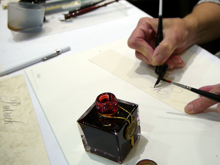 Joy Daniels demonstrates copperplate calligraphy at Fountain Pens at the London Writing Equipment Show